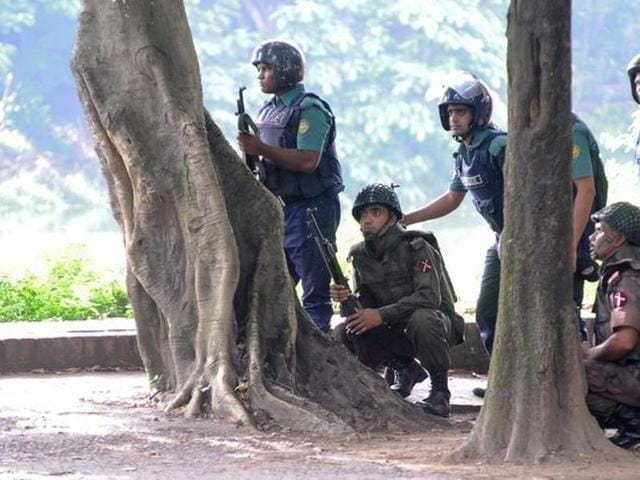 Army soldiers take their positions near the Holey Artisan restaurant after Islamist militants attacked the upscale cafe in Dhaka, Bangladesh.