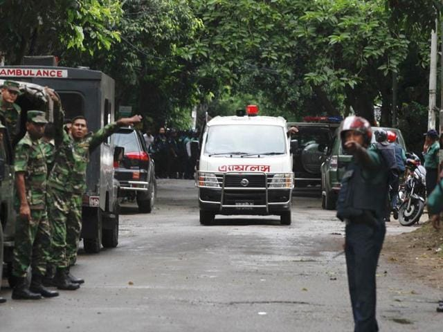 An ambulance transports bodies found at a restaurant popular with foreigners after heavily armed militants attacked it on Friday night in Dhaka, Bangladesh, Saturday, July 2, 2016.