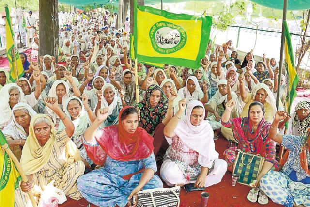 Farmers protesting outside the mini-secretariat in Bathinda on Friday.