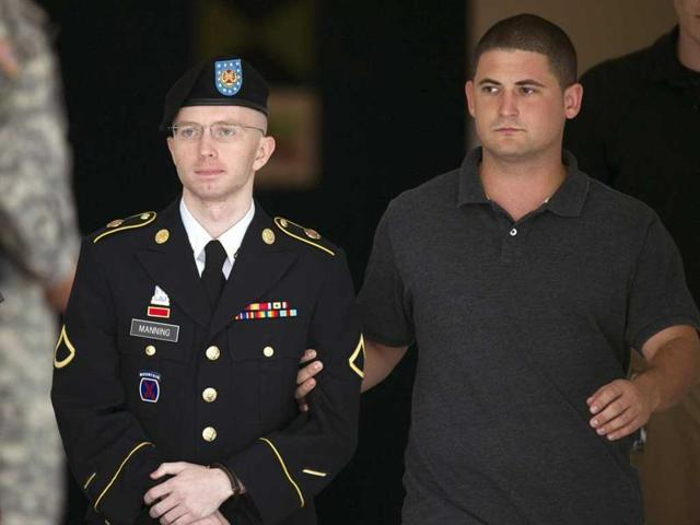 Chelsea Manning (L) formerly know as Bradley, is seen here being escorted from a courthouse at Fort Mead.