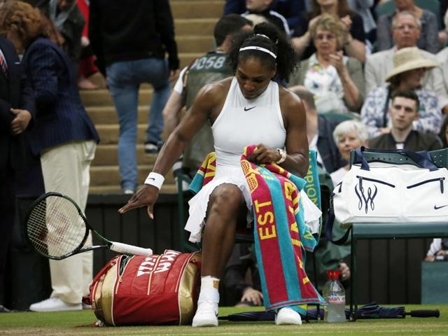 Serena Williams smashes her racket after losing the first set to Christina McHale.