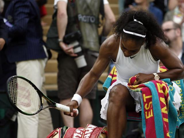 Serena Williams of the US smashes her racket after losing her first set to Christina McHale during their women's singles match on day five of the Wimbledon Tennis Championships in London.(AP Photo)