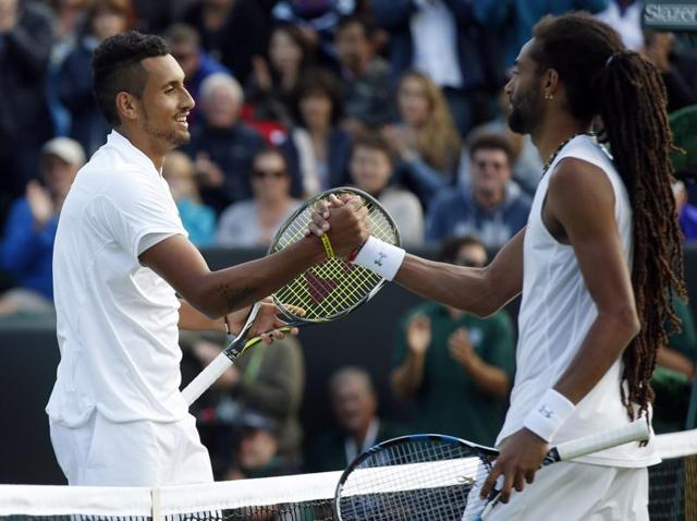 Kyrgios and Brown shake hands at the net after the match.