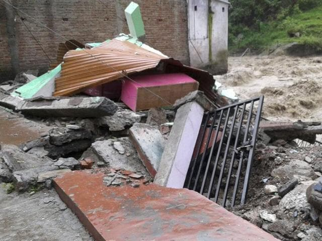 House damaged due to heavy rainfall at Maithana village in Chamoli district, India, on Friday, July 01, 2016.