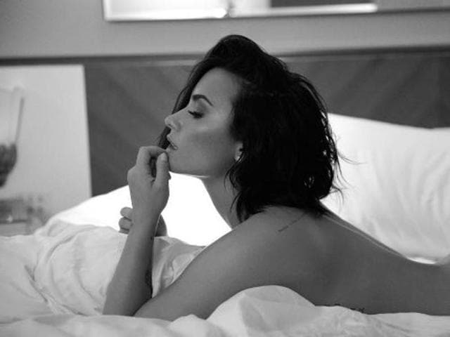 Demi Lovato has shared a series of pictures on Instagram with nothing but bed sheets to cover her modesty.
