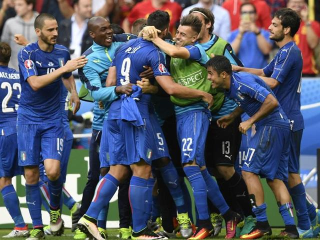 Italy players react after Pelle scored a second goal for the team during Euro 2016 round of 16 football match between Italy and Spain at the Stade de France stadium in Saint-Denis, near Paris.