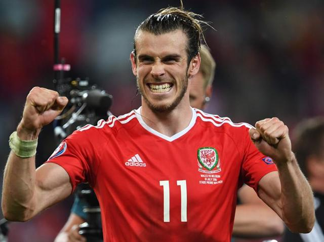 Wales' forward Gareth Bale (centre) celebrates with teammates at the end of the Euro 2016 quarterfinal football match between Wales and Belgium at the Pierre-Mauroy stadium in Villeneuve-d'Ascq near Lille.