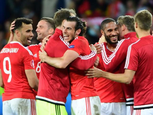 Wales' forward Gareth Bale (centre) celebrates with team mates after the Euro 2016 quarterfinal football match against Belgium at the Pierre-Mauroy stadium in Villeneuve-d'Ascq near Lille.