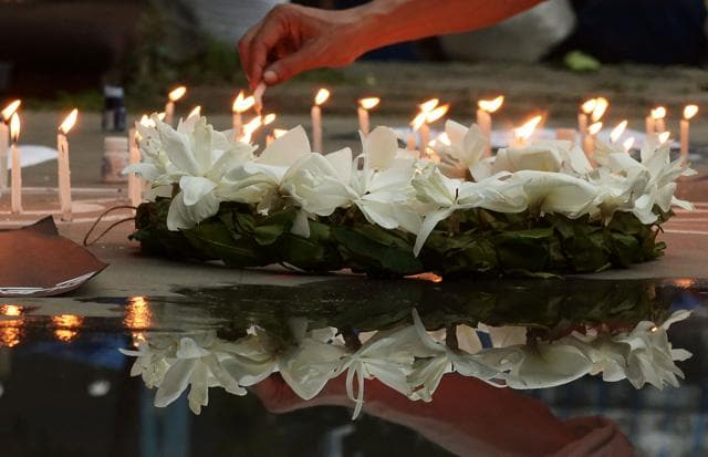 Indian social activists light candles during a protest in Kolkata on July 2, 2016, against a fatal attack on a restaurant in the Bangladeshi capital Dhaka.  An Indian, Tarishi Jain, was among the 20 people killed in the attack claimed by the IS.