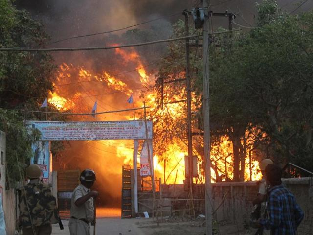 Policemen stand guard outside violence-hit Jawahar Bagh area in Mathura.