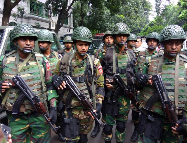 Soldiers gather near the Holey Artisan restaurant after Islamist militants attacked the upscale cafe in Dhaka.