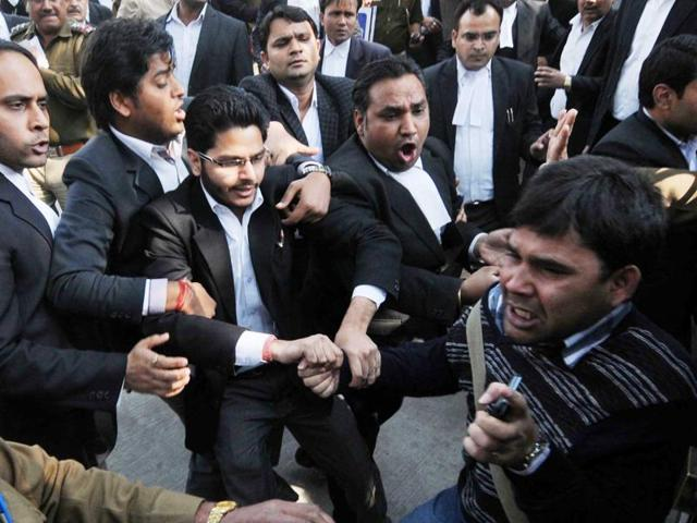 Lawyers assaulting a journalist outside Patiala House Court in New Delhi on February 17, 2016.