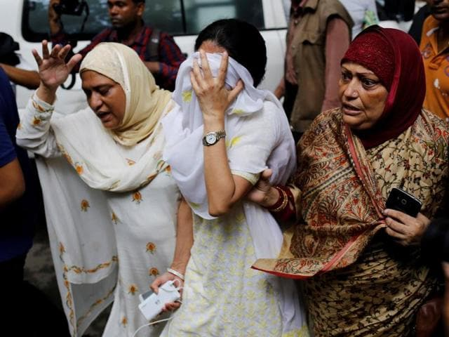 People react near the Holey Artisan restaurant after Islamist militants attacked the upscale cafe in Dhaka.