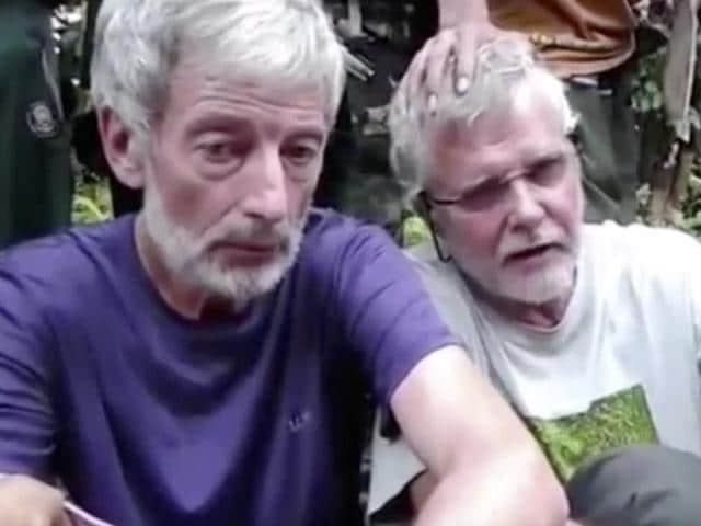 This file image made from undated militant video shows Canadians Robert Hall (left) and John Ridsdel in captivity of suspected Abu Sayyaf militants in Philippines.