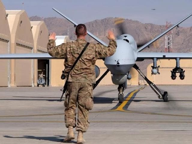 A US airman guides an  Air Force MQ-9 Reaper drone as it taxis to the runway at Kandahar Airfield, Afghanistan March 9, 2016.  According to figures released by the US, between 64-116 civilians were killed in drone strikes  outside 'areas of active hostilities'.