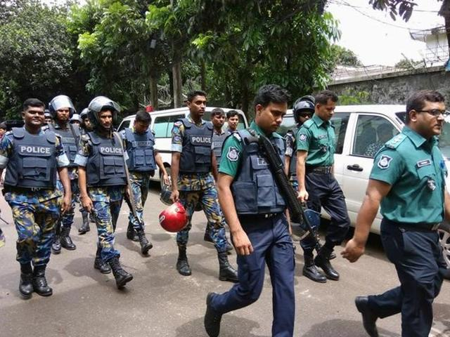 An injured member of the police personnel is carried away by his colleagues, after gunmen stormed a restaurant popular with expatriates in the diplomatic quarter of the Bangladeshi capital, in Dhaka July 1, 2016.