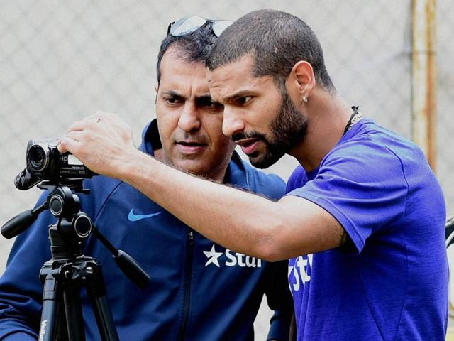 Indian cricketer Shikhar Dhawan leaves after batting in the nets during a training session.