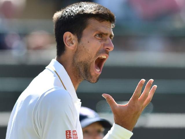 Sam Querrey celebrates winning his match against Serbia's Novak Djokovic.