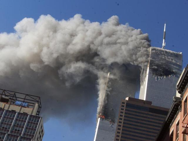 In this Sept. 11, 2001 file photo, smoke rising from the burning twin towers of the World Trade Center after hijacked planes crashed into the towers, in New York City.
