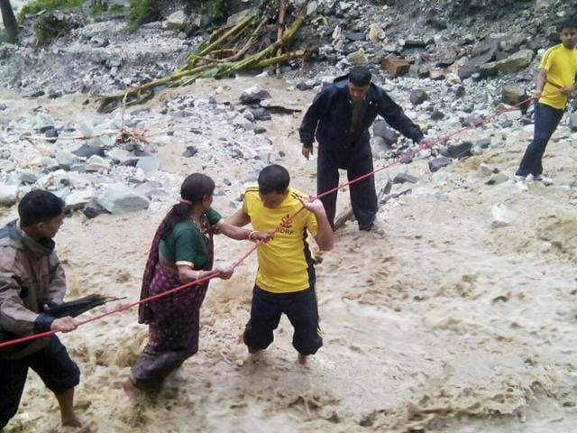Rescue operations in progress at different places after heavy rains in Uttarakhand, India, on Saturday, July 2, 2016.