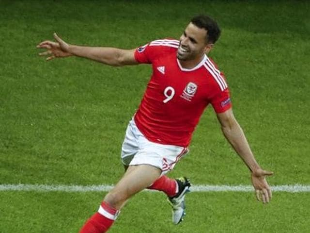 Wales' Hal Robson-Kanu celebrates after scoring their second goal against Belgium at Stade Pierre-Mauroy, Lille, France.