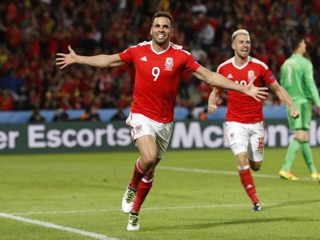 Hal Robson-Kanu celebrates after scoring their second goal.
