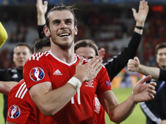 Wales' Hal Robson-Kanu celebrates with Gareth Bale after scoring their second goal.