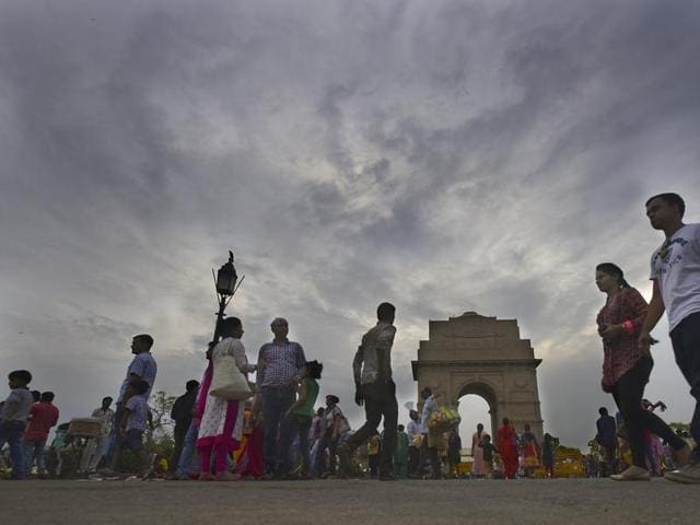 People enjoy the pleasant weather at India Gate in New Delhi on Saturday.