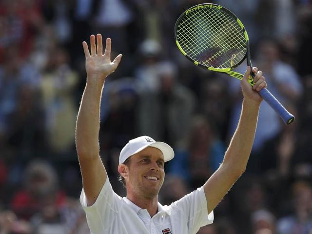 Sam Querrey shakes hands with Novak Djokovic at the net after the match.