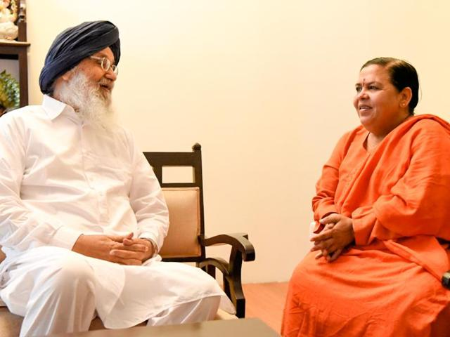 Punjab chief minister Parkash Singh Badal with Union water resources minister Uma Bharti on Sunday.