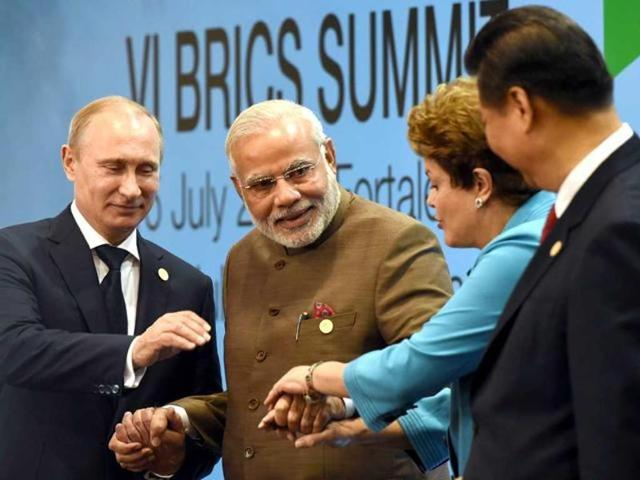 Brazil's President Dilma Rousseff, Chinese President Xi Jinping, Prime Minister Narendra Modi and Russian Russian President Vladimir Putin pose for the photo during the 6th BRICS Summit in Fortaleza.