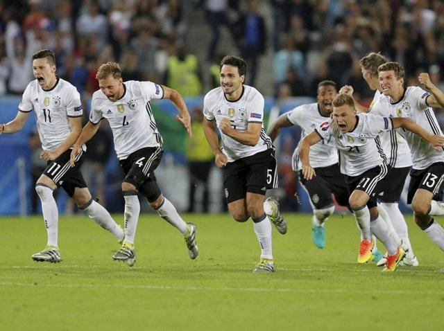 German players set off to celebrate after the winning penalty.