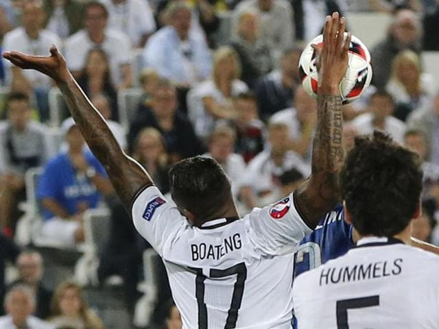 Germany's Jerome Boateng (right) handles the ball in the penalty area during the Euro 2016 quarterfinal football match against Italy, at the Nouveau Stade in Bordeaux, France.