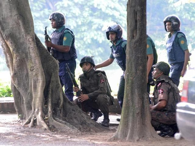 Army soldiers take their positions near the Holey Artisan restaurant after Islamist militants attacked the upscale cafe in Dhaka.