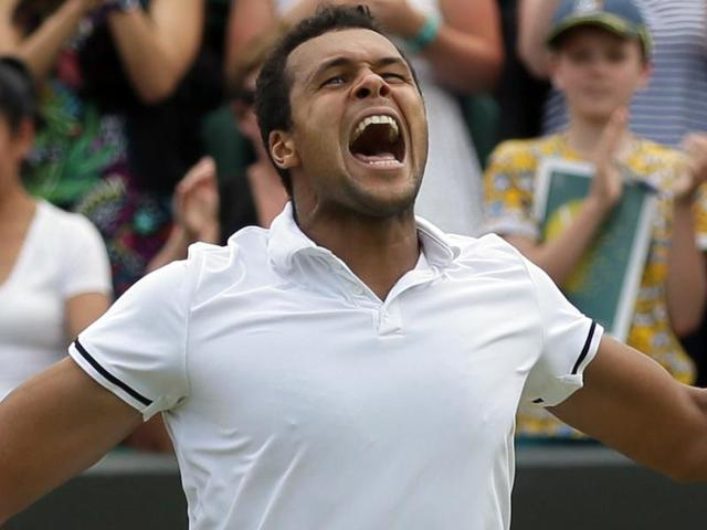 Jo-Wilfried Tsonga of France celebrates after beating John Isner of the U.S in their men's singles match.