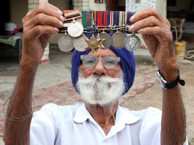 The soldier holding up his medals: Naik Sarup Singh fought the Japanese in Burma as part of the British army in World War II. That was duty. He fought Pakistanis in Jammu and Kashmir in 1947-48. That was for the nation.
