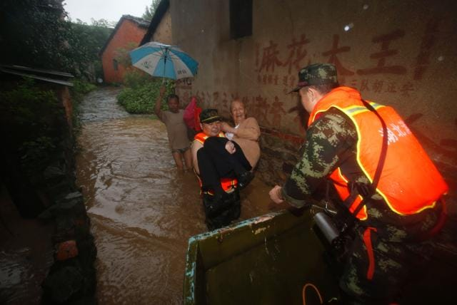 This picture taken on July 1, 2016 shows an elderly man being rescued from a flooded area in Xinzhou, in China's central Hubei province.