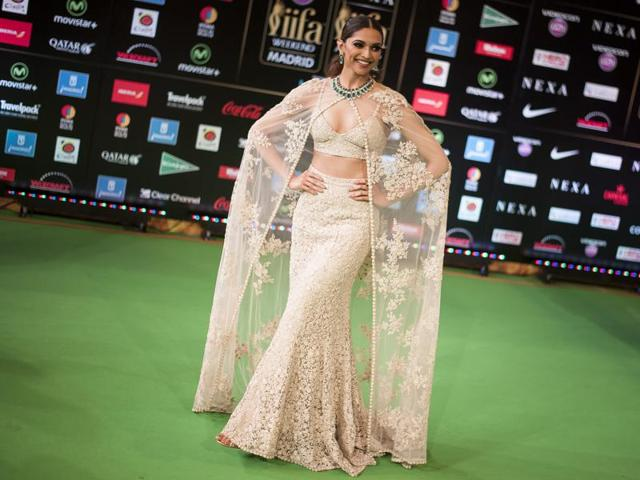 Actor Deepika Padukone at the IIFA Awards in Madrid, Spain.  Here she is, wearing a Sabyasachi caped number.
