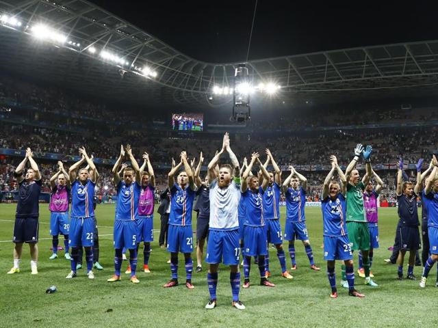 Iceland players celebrate after they won the round of 16 match against England at Stade de Nice, Nice, France.