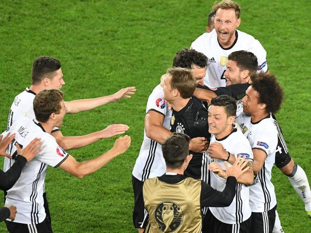 Germany's players celebrate after winning the Euro 2016 quarterfinal football match between Germany and Italy at the Matmut Atlantique stadium in Bordeaux.