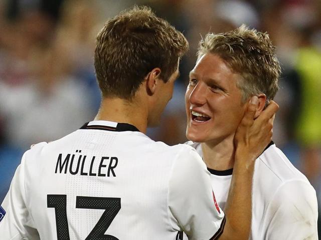 Germany's Thomas Muller and Bastian Schweinsteiger celebrate after the game.