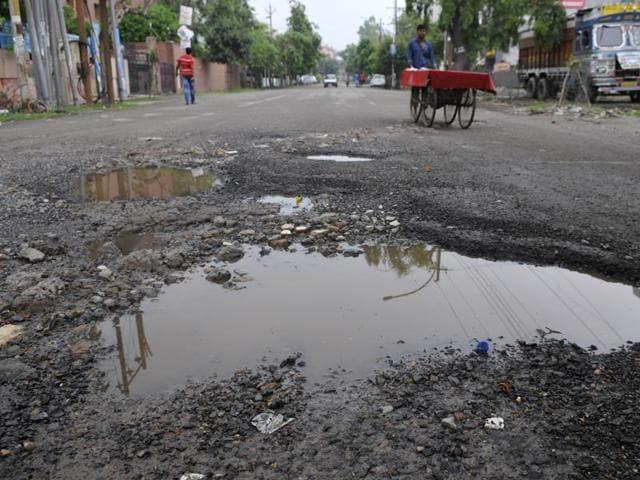Broken roads in Noida Sector 1.