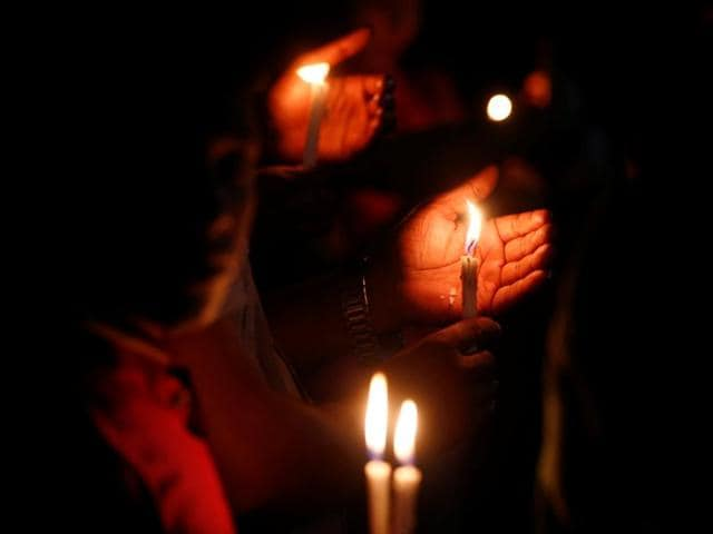 Bangladeshis light candles and sing songs as they pay tribute to those killed in the attack at the Holey Artisan Bakery in Dhaka on Sunday.