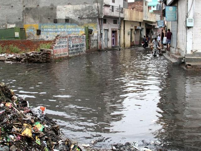 Dirty water from the Buddha Nullah overflowed and entered houses after the heavy spell of rain.