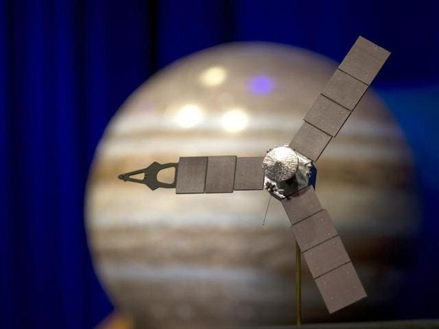 A 1/4 scale model of the Juno spacecraft is displayed as NASA officials and the public look forward to the Independence Day arrival of the the Juno spacecraft to Jupiter, at JPL on June 30, 2016 in Pasadena, California. After having traveling nearly 1.8 billion miles over the past five years, the NASA Juno spacecraft will arrival to Jupiter on the Fourth of July to go enter orbit and gather data to study the enigmas beneath the cloud tops of Jupiter.