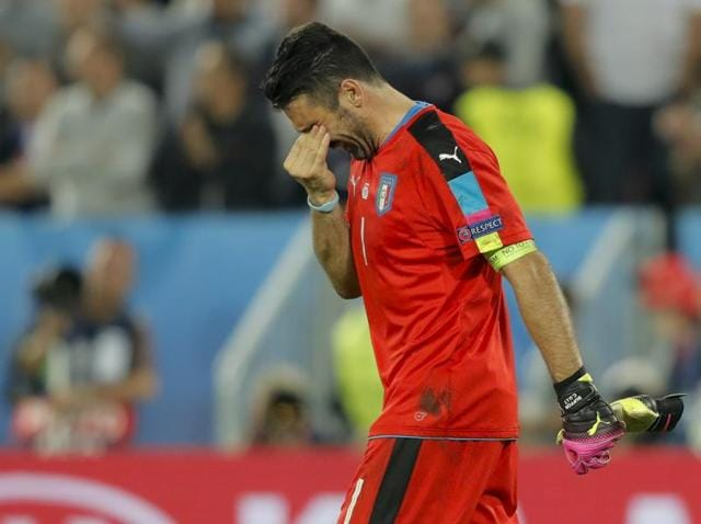 Italy goalkeeper Gianluigi Buffon walks off the pitch at the end of the Euro 2016 quarterfinal soccer match between Germany and Italy.