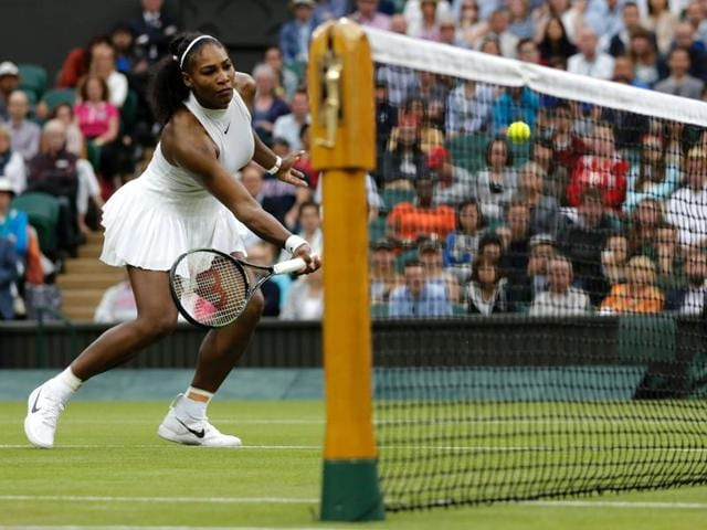 US player Serena Williams returns to US player Christina McHale during their women's singles second round match on the fifth day of the 2016 Wimbledon Championships at The All England Lawn Tennis Club in Wimbledon, southwest London.
