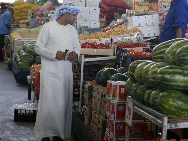 An Emirati man looks at fruits and vegetables at a market during the Muslim fasting month of Ramzan in the Gulf emirate of Dubai.