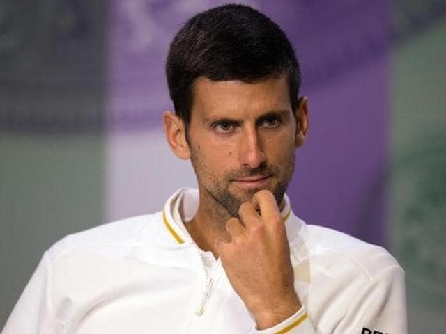 Serbia's Novak Djokovic reacts while playing US player Sam Querrey during their men's singles match.