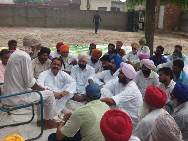 Congress leader Manpreet Badal interacting with victims' families at Joga village in Mansa on Sunday.